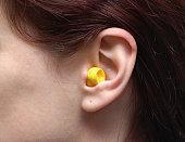 One single ear with a ear plug in it