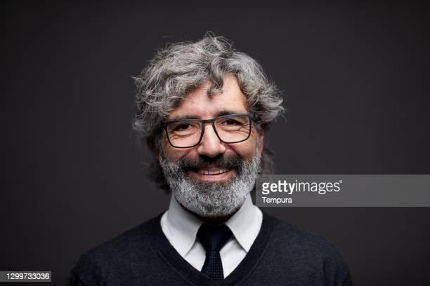 one spanish senior man headshot portrait smiling at the camera. - neckwear stock pictures, royalty-free photos & images