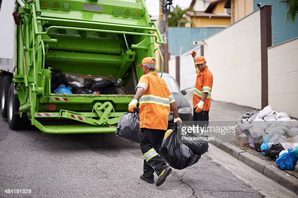 one street at a time... - street sweeper stock pictures, royalty-free photos & images