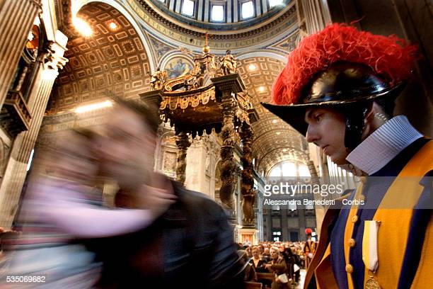 One Swiss Guard stands inside St. Peter's Basilica during Vatican State secretary Cardinal Tarcisio Bertone's celebration of a mass for the...