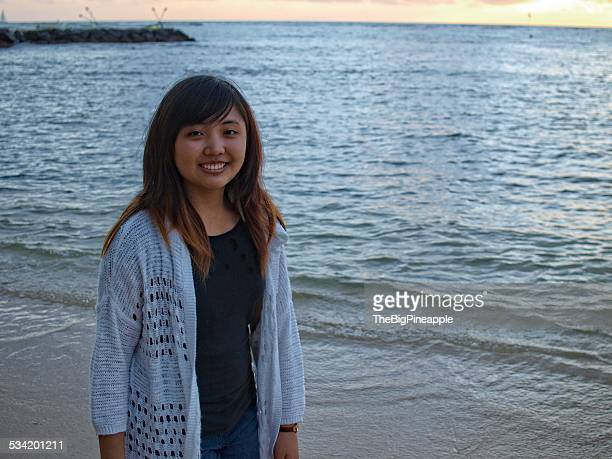 One teen on beach at sunset