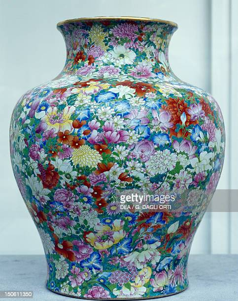 One thousand flowers vase bearing Qianlong mark under the base Famille rose White ceramic with enamel decorations from the province of Jingdezhen...
