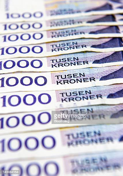 One thousand krone Norwegian bank notes are seen displayed for a photograph at a Forex currency exchange center in Oslo Norway on Thursday April 26...