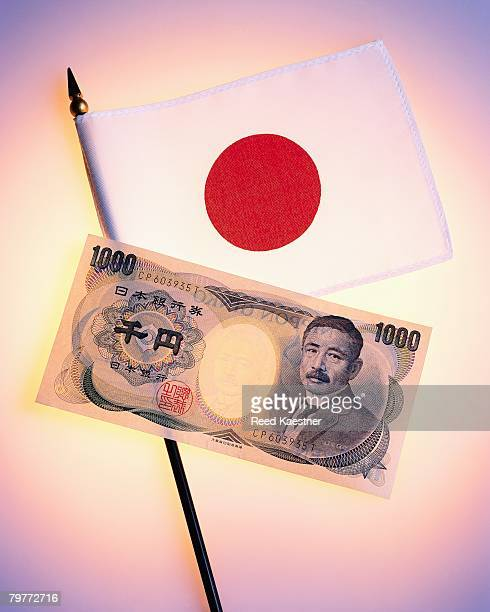One Thousand Yen Bank Note and Japanese Flag