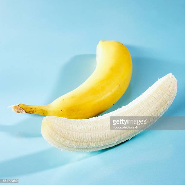 One unpeeled and one peeled banana