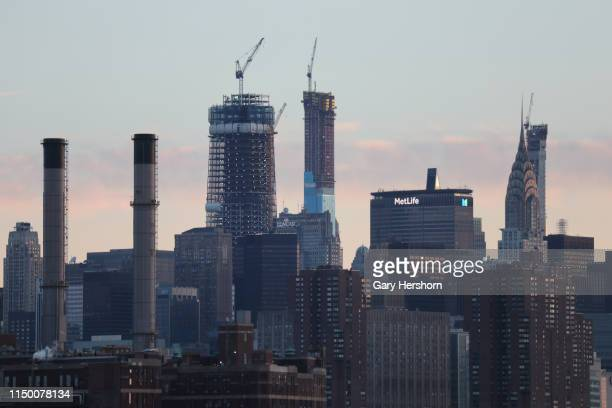 One Vanderbilt and Central Park Tower rise above 30 Rockefeller Center at sunrise on May 18 2019 in New York City