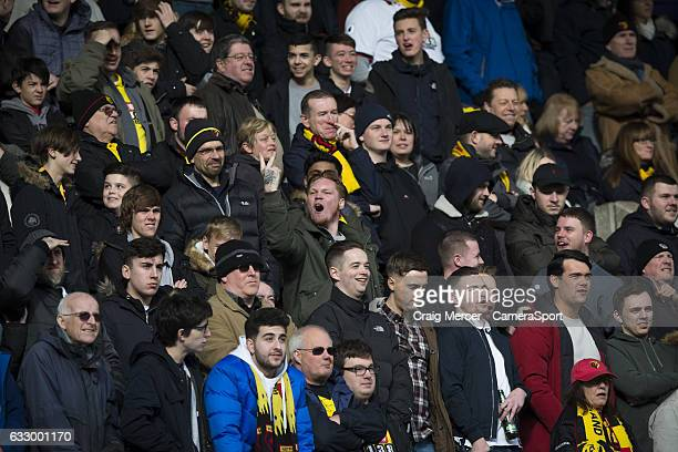 One Watford fan greets the home support during the Emirates FA Cup Fourth Round match between Millwall and Watford at The Den on January 29 2017 in...