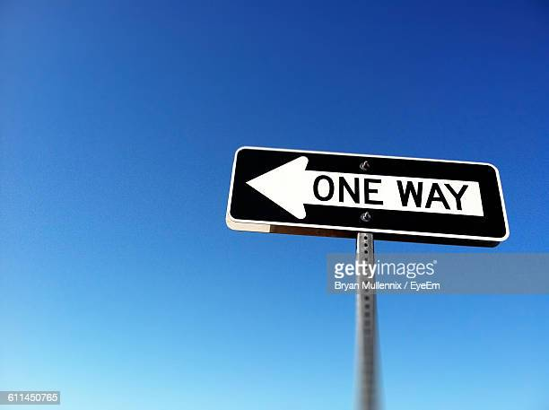 one way arrow sign against clear blue sky - one direction stock pictures, royalty-free photos & images