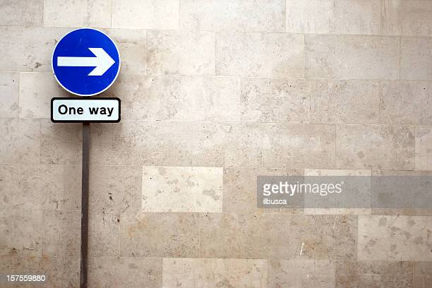 one way arrow sign with copy space - one direction stock pictures, royalty-free photos & images