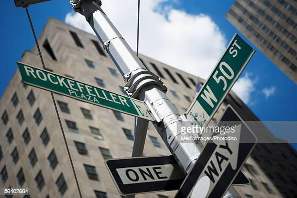 one way' sign and road signs of rockefeller plaza and west 50th street, new york city, ny, usa - rockefeller center stock pictures, royalty-free photos & images