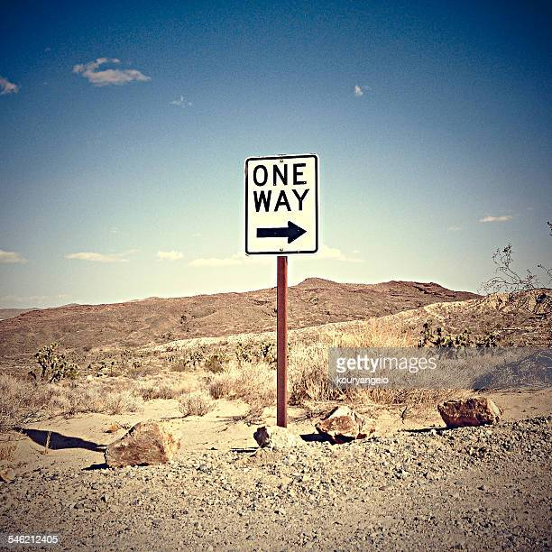 one way sign in desert, california, america, usa - one direction stock pictures, royalty-free photos & images
