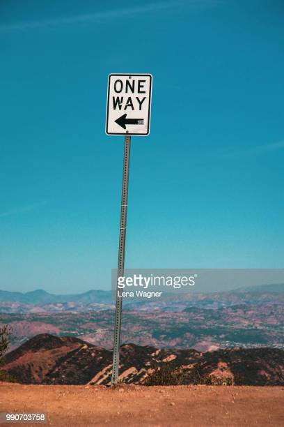 one way sign on mountain - one direction tour stock pictures, royalty-free photos & images