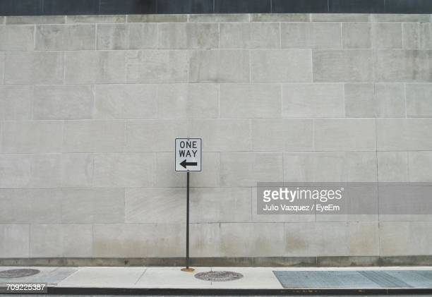 one way sign on street - one direction stock pictures, royalty-free photos & images