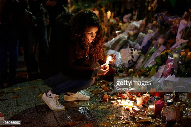 One week after the fatal terrorist attack at the Bataclan Theater Laura Cappia lights candles in remembrance of the 89 people who died Laura was at a...