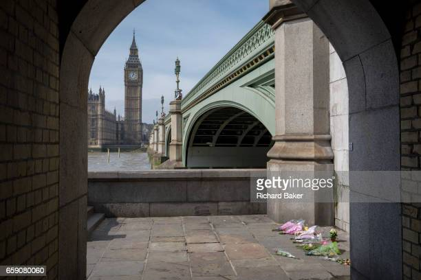 One week after the terrorist attack in the UK capital Londoners and visitors to Britain pay their respects to the scene where flower memorials are...