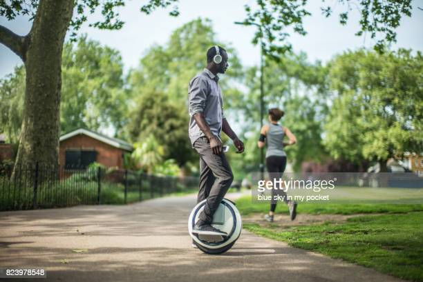 one wheel self balancing electric scooter. - mobility scooter stock photos and pictures