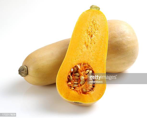 One whole and one half butternut squash sliced open