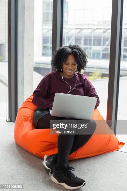 one woman at work - europa occidentale foto e immagini stock