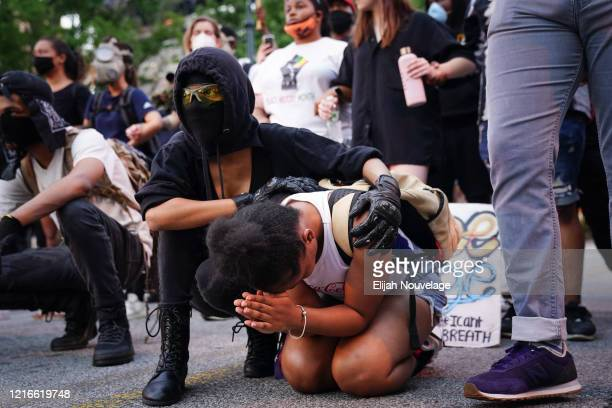 One woman comforts another as she prays during a demonstration on May 31 2020 in Atlanta Georgia Across the country protests have erupted following...