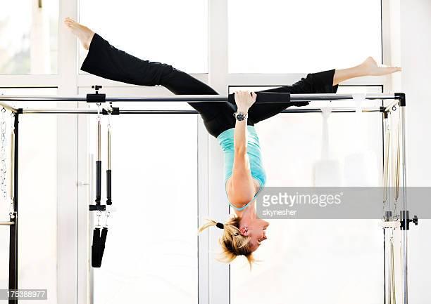 One woman exercising gymnastics Pilates.