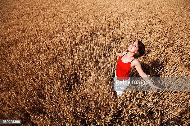 One woman feeling free in the wheat field