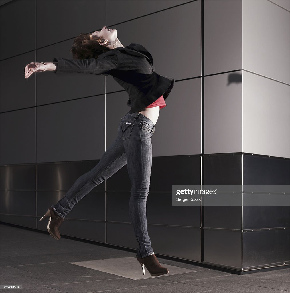 One Woman Jumping Outdoors Urban Setting Stock Photo - Getty