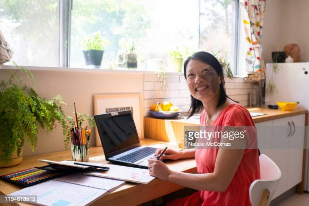 one woman on laptop at home