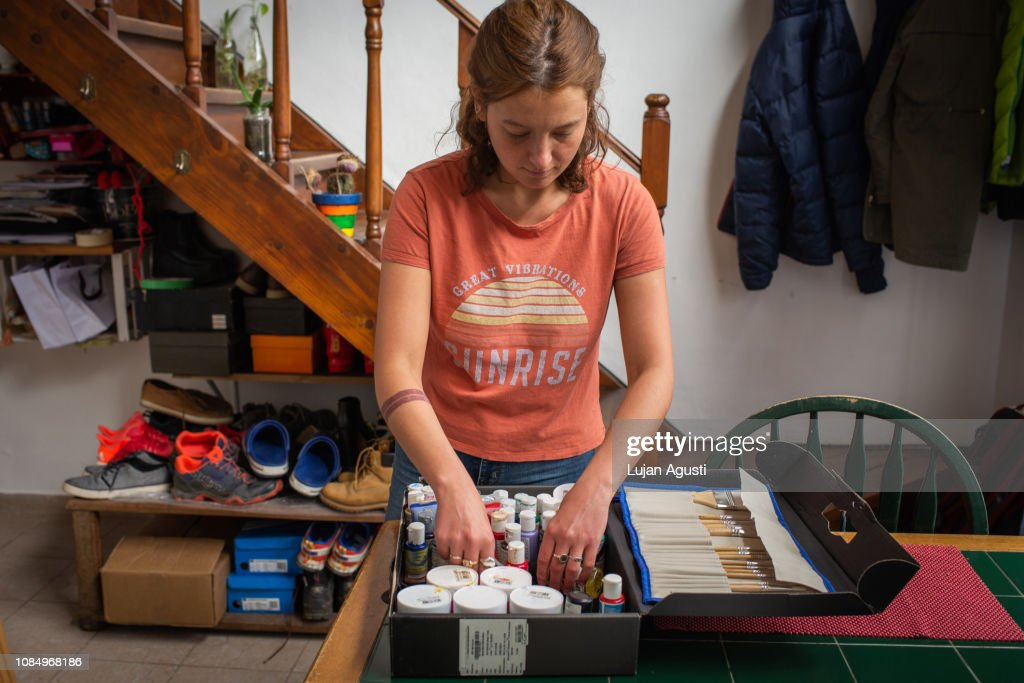 Woman painting a room stock photo. Image of painter