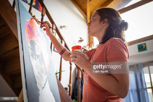 one woman painting - hobbies stock pictures, royalty-free photos & images