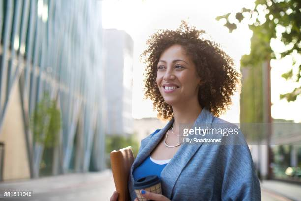 One woman smiling in street