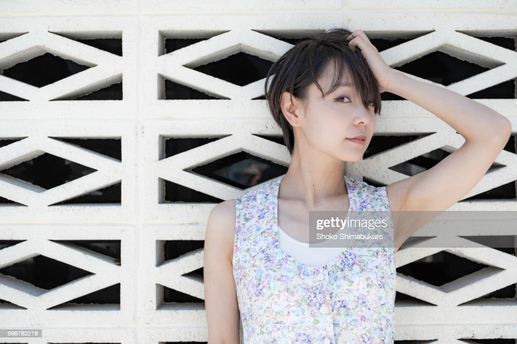 One woman who travels the streets of the American atmosphere of Okinawa. : Stock Photo