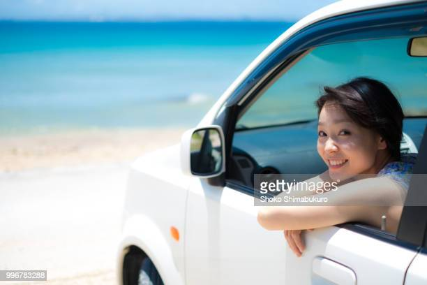 one woman who travels the streets of the american atmosphere of okinawa. - land vehicle stock pictures, royalty-free photos & images