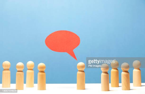 one wooden figurine speaking to a crowd - candidate stock pictures, royalty-free photos & images