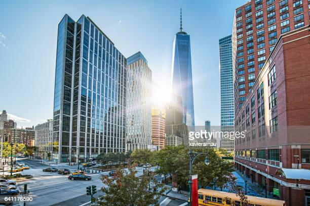 one world trade center against sky on sunny day - lower manhattan stock photos and pictures