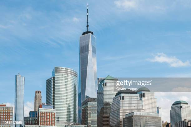 one world trade center by buildings against sky in city - one world trade center stock pictures, royalty-free photos & images