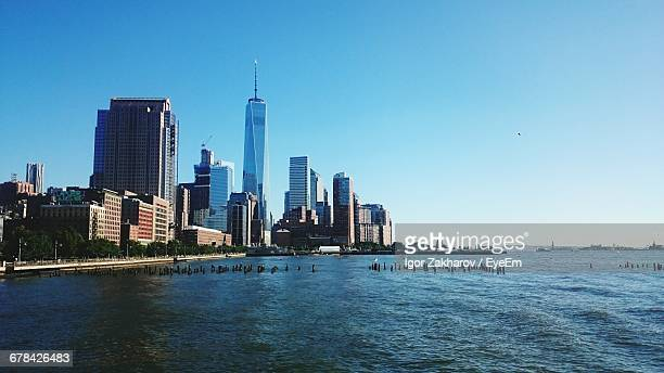 One World Trade Center In City By East River Against Clear Sky