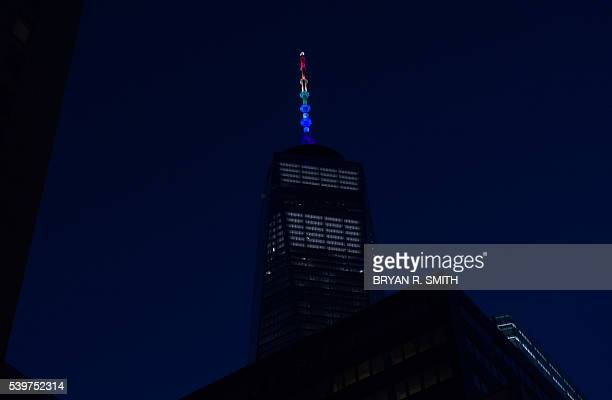 One World Trade Center is lit in the rainbow colors in New York on June 12 in reaction to the mass shooting at a gay nightclub in Orlando Florida...
