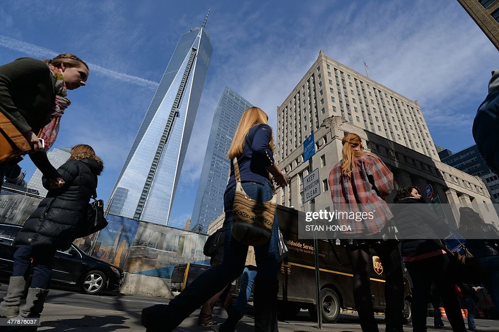 One World Trade Center (L) is seen as people walk on Church Street in Lower Manhattan March 11, 2014 in New York. AFP PHOTO/Stan HONDA