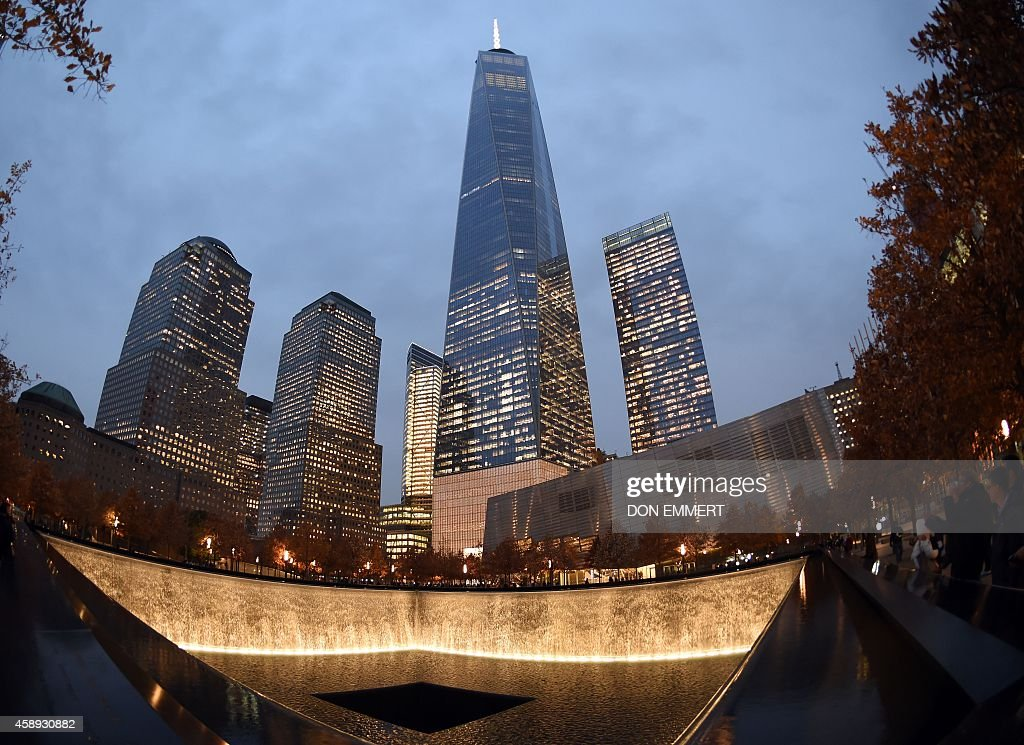 One World Trade Center raises high above a reflecting pool November 13, 2014 in New York. Patrick Foye, Executive Director of the Port Authority of New York and New Jersey, says that new tenants continue to sign contracts to lease space in the building. AFP PHOTO/Don Emmert / AFP / DON
