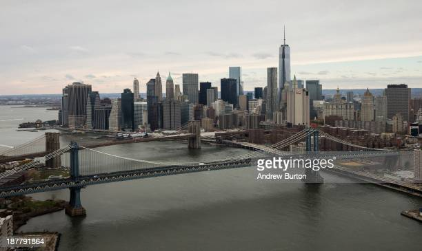 One World Trade Center seen behind the Manhattan Bridge and Brooklyn Bridge towers over lower Manhattan on November 12 2013 in New York City The...