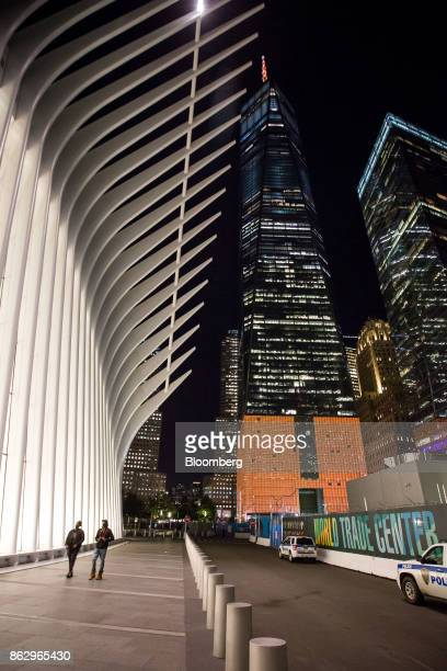 One World Trade Center stands lit in orange to support a bid for Amazoncom Inc's second headquarters in New York US on Wednesday Oct 18 2017 More...