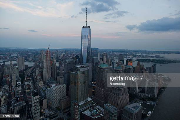 One World Trade Center stands the Lower Manhattan skyline at dusk in this aerial photograph taken above New York US on Friday June 19 2015 The...