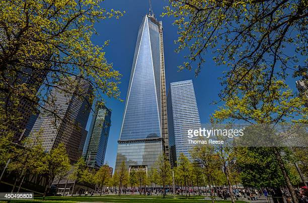 One World Trade Center, viewed from the 9/11 Memorial, On May 2nd workers raised the 408-foot spire will serve as a broadcast antenna to a temporary...