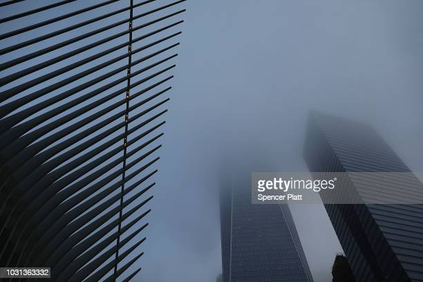 One World Trade towers above the Oculus during a morning commemoration ceremony for the victims of the terrorist attacks seventeen years after the...