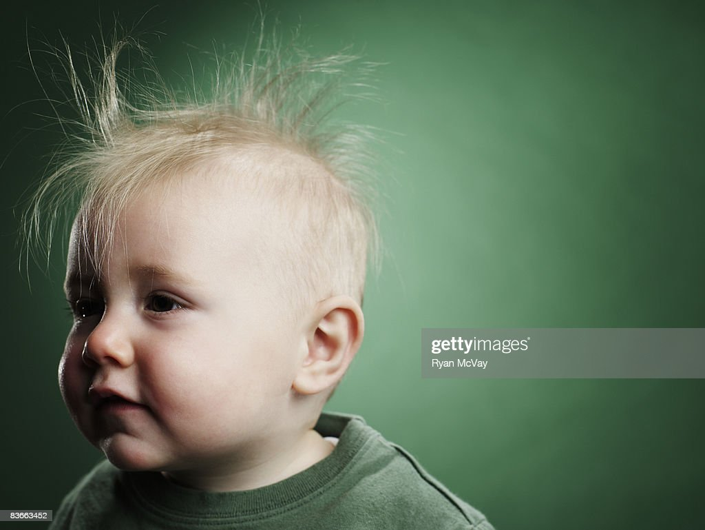 One year old boy with hair sticking up.  : Stock Photo