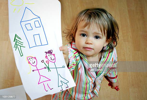 one year old girl holding a drawing - kids art stock pictures, royalty-free photos & images