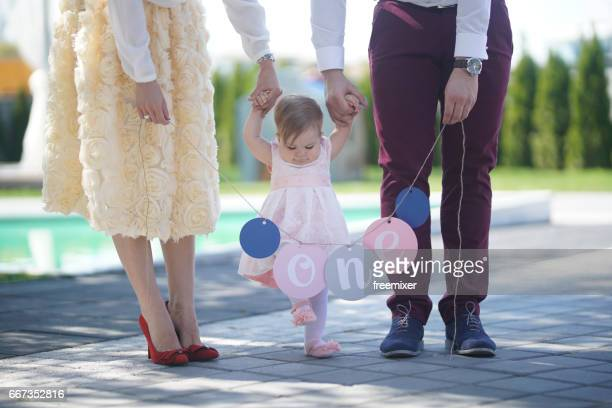 One year old wth her parents