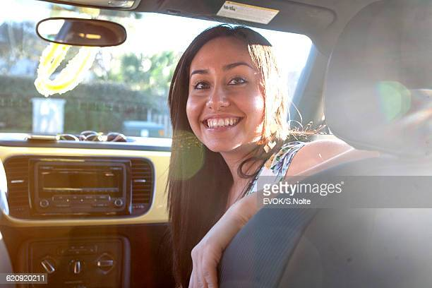 One  young adult women in car