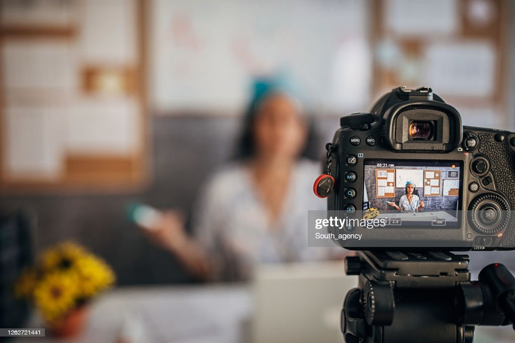 One young female professor holding online class for e-learning students : Stock Photo