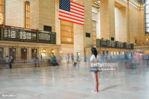 one young lady waiting in grand central station - railroad station stock pictures, royalty-free photos & images